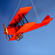 Dangling Framed Prints - Red Plane on Blue Framed Print by Art Block Collections