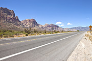 Gravel Road Prints - Red Rock Canyon road leading to Las Vegas NV. Print by Gino Rigucci