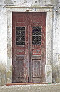 Cobblestone Prints - Red Weathered Door of Pombal Print by David Letts