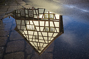 Timber House Prints - Reflection of a beautiful old half-timbered house in a puddle of water Print by Matthias Hauser