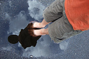 Stands Prints - Reflection of boy in a puddle of water Print by Matthias Hauser