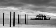 Grey Clouds Framed Prints - Remains of the West Pier in Brighton Framed Print by Semmick Photo