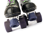 Old Skates Photo Prints - Retro roller skates Print by Lusoimages