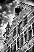 Historic Buildings Images Posters - Rising Up in Bruges Poster by John Rizzuto