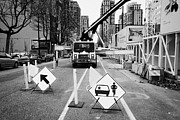 Construction Zone Framed Prints - road closed to traffic to allow large articulated crane operate at building site Vancouver BC Canada Framed Print by Joe Fox