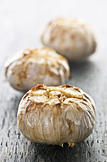 Texture Metal Prints - Roasted garlic bulbs Metal Print by Elena Elisseeva
