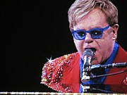 Elton John Photos - Rocket Man by Aaron Martens