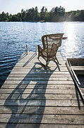 Rocking Chairs Photo Prints - Rocking chair on dock Print by Elena Elisseeva