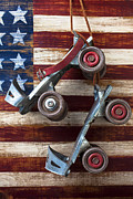 Old Skates Photo Prints - Rollar skates with wooden flag Print by Garry Gay
