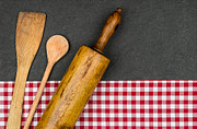 Slate Pattern Posters - Rolling pin with wooden spoon on a slate plate  Poster by Palatia Photo