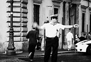Police Officer Framed Prints - Roman Municipal policeman directs traffic at a pedestrian crossing in the Via Teatro Marcello Rome Lazio Italy Framed Print by Joe Fox
