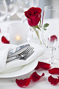 Glassware Posters - Romantic dinner setting with rose petals Poster by Elena Elisseeva