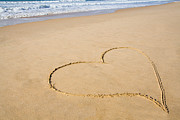 Drawn Framed Prints - Romantic heart drawn in the smooth beach sand Framed Print by Lusoimages