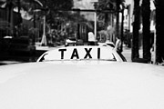 Rank Framed Prints - Rooftop Taxi Sign On Cab In Row Of Yellow Cab Taxis In Miami South Beach Florida Usa Framed Print by Joe Fox