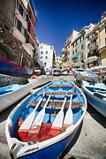 Boats In Harbor Posters - Row Boats of Riomaggiore Poster by George Oze