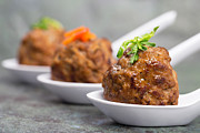Pea Photos - Row of Asian meatballs by Jane Rix