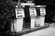 Small Village Framed Prints - Row Of Traditional Petrol And Diesel Pumps On Old Forecourt Of Shop In Courtown Not Self Service Framed Print by Joe Fox