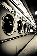 Washing Machine Posters - Row of Washing Machines in Laundromat Poster by Amy Cicconi