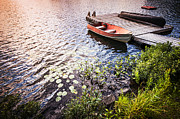 Rowboat At Lake Shore At Sunrise Print by Elena Elisseeva