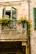 Adorning Prints - run down Italian balcony with shutters and flowers Print by Peter Noyce