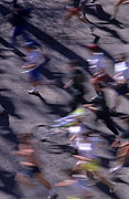 Marathons Prints - Runners along street in a marathon blurred and abstract Print by Jim Corwin