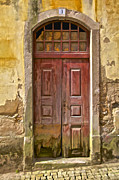 Abandonment Photo Framed Prints - Rustic Red Wood Door of the Medieval Village of Pombal Framed Print by David Letts