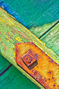 Peeled Prints - Rusty bolt on rotten green wood Print by Silvia Ganora