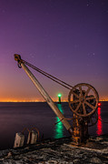 Rusty Davit And Two Lighthouses Print by Semmick Photo