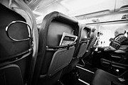 Cabin Interior Framed Prints - Safety Card And In Flight Magazine In Seat Pocket Interior Of Jet2 Aircraft Passenger Cabin In Fligh Framed Print by Joe Fox