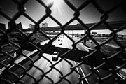 Looking Down Framed Prints - safety chain link fence screen looking down over i-15 interstate in Las Vegas Nevada USA Framed Print by Joe Fox
