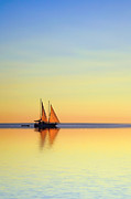 Tropical Sunset Prints - Sailing Boat on a Tropical Ocean at Twilight Print by Colin and Linda McKie