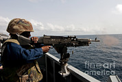 Sailor Prints - Sailor Fires A M240b Machine Gun Aboard Print by Stocktrek Images