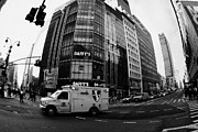Manhaten Framed Prints - Saint Vincent Catholic Medical Centre Ambulance Crossing 6th Avenue And Broadway Framed Print by Joe Fox