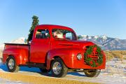 Christmas Holiday Scenery Art - Santa Driving A Vintage Red Ford by Michael DeYoung