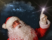 Claus Posters - Santa pointing with magical light to the sky Poster by Sandra Cunningham