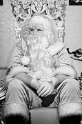 Santa Claus Posters - Santa sitting on his throne looking away from camera in grotto set up  Poster by Joe Fox