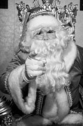 Father Christmas Prints - Santa sitting on his throne pointing to camera in grotto set up Print by Joe Fox