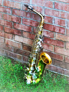 Saxophones Prints - Saxophone Against Brick Print by Susan Savad