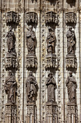 Religious Structure Framed Prints - Sculptures of Saints on Seville Cathedral Facade Framed Print by Artur Bogacki
