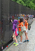 Searching A Loved Ones Name On The Vietnam Veterans Memorial Print by Jim Fitzpatrick