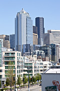 Light Poles Framed Prints - Seattle skyline architecture. Framed Print by Gino Rigucci