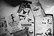 Leaflets Prints - selection of leaflets advertising girls laid out on a hotel bed in Las Vegas Nevada USA Print by Joe Fox