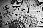 Cash Money Framed Prints - Selection Of Leaflets Advertising Girls Laid Out On A Hotel Bed With Us Dollars Cash In An Envelope  Framed Print by Joe Fox