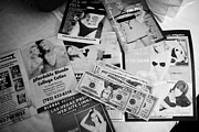 Leaflets Prints - selection of leaflets advertising girls laid out on a hotel bed with us dollars cash in Las Vegas Ne Print by Joe Fox