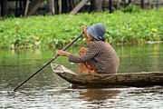 Siem Reap Photo Posters - Senior Woman Paddling a Boat Poster by Artur Bogacki