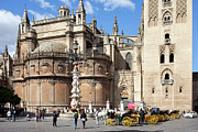 Carriages Posters - Seville Cathedral in the Old Town Poster by Artur Bogacki