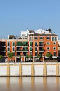Seville House River View Print by Artur Bogacki