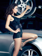 Wrecked Cars Prints - Sexy mechanic girl posing with cars Print by Oleksiy Maksymenko