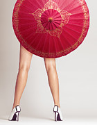 Glamour Art - Sexy woman legs behind red Chinese umbrella by Oleksiy Maksymenko