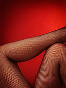 Oleksiy Maksymenko Framed Prints - Sexy woman legs in fishnet stockings on red Framed Print by Oleksiy Maksymenko